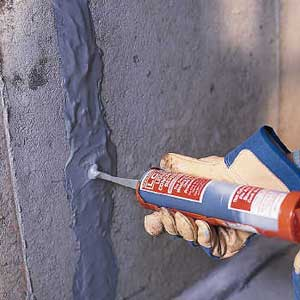 Injecting epoxy into foundation wall crack