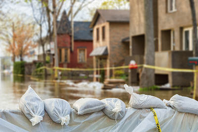 Sandbags placed in front of homes to protect from flood waters